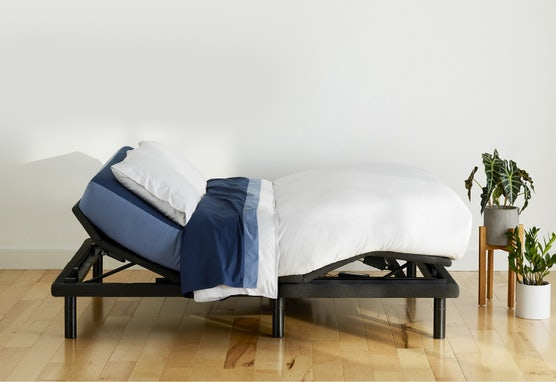 Adjustable Pro Bed Frame with head and feet raised. Free in-home setup.