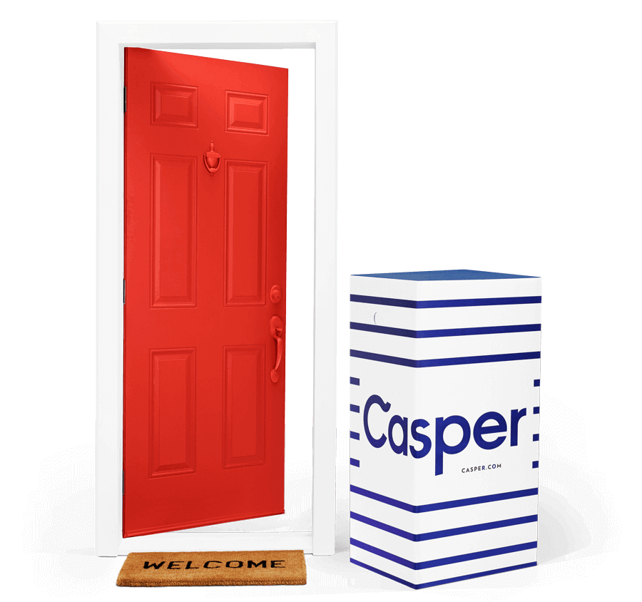 A Casper mattress box standing next to an open door.